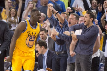 March 1, 2016; Oakland, CA, USA; Golden State Warriors forward Draymond Green (23) celebrates after making a three-point basket against the Atlanta Hawks during overtime at Oracle Arena. The Warriors defeated the Hawks 109-105 in overtime. Mandatory Credit: Kyle Terada-USA TODAY Sports