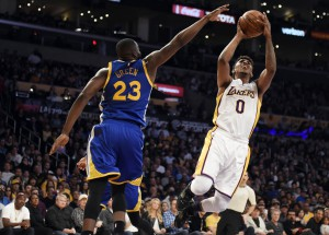 Mar 6, 2016; Los Angeles, CA, USA; Los Angeles Lakers forward Nick Young (0) shoots against Golden State Warriors forward Draymond Green (23) during the NBA game at the Staples Center. Mandatory Credit: Richard Mackson-USA TODAY Sports