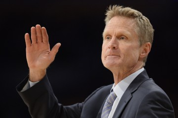 Mar 6, 2016; Los Angeles, CA, USA; Golden State Warriors head coach Steve Kerr waves during the NBA game against the Los Angeles Lakers at the Staples Center. Mandatory Credit: Richard Mackson-USA TODAY Sports