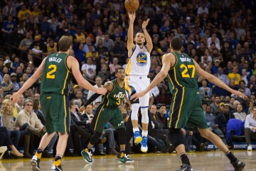 Mar 9, 2016; Oakland, CA, USA; Golden State Warriors guard Stephen Curry (30) shoots the ball from from beyond the half court line over Utah Jazz guard Trey Burke (3), forward Joe Ingles (2) and center Rudy Gobert (27) during the second quarter at Oracle Arena. Mandatory Credit: Kelley L Cox-USA TODAY Sports