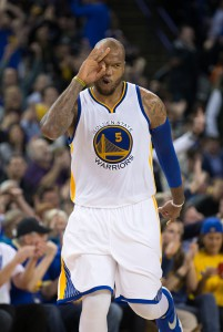 Mar 9, 2016; Oakland, CA, USA; Golden State Warriors center Marreese Speights (5) celebrates after a three point basket against the Utah Jazz during the third quarter at Oracle Arena. The Warriors defeated the Jazz 115-94. Mandatory Credit: Kelley L Cox-USA TODAY Sports