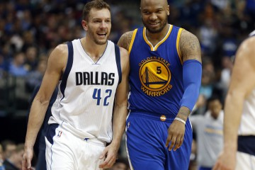 Mar 18, 2016; Dallas, TX, USA;  Dallas Mavericks forward David Lee (42) walks with Golden State Warriors center Marreese Speights (5) during the game at American Airlines Center. Golden State won 130-112. Mandatory Credit: Tim Heitman-USA TODAY Sports