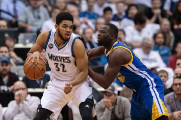 Mar 21, 2016; Minneapolis, MN, USA; Minnesota Timberwolves center Karl-Anthony Towns (32) dribbles in the first quarter against the Golden State Warriors forward Draymond Green (23) at Target Center. Mandatory Credit: Brad Rempel-USA TODAY Sports