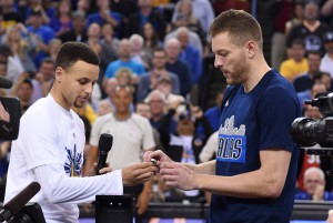 March 25, 2016; Oakland, CA, USA; Golden State Warriors guard Stephen Curry (30) gives Dallas Mavericks forward David Lee (42) his NBA championship ring before the game at Oracle Arena. Mandatory Credit: Kyle Terada-USA TODAY Sports