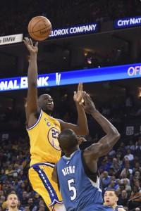 April 5, 2016; Oakland, CA, USA; Golden State Warriors forward Draymond Green (23) shoots the basketball against Minnesota Timberwolves center Gorgui Dieng (5) during the third quarter at Oracle Arena. The Timberwolves defeated the Warriors 124-117. Mandatory Credit: Kyle Terada-USA TODAY Sports