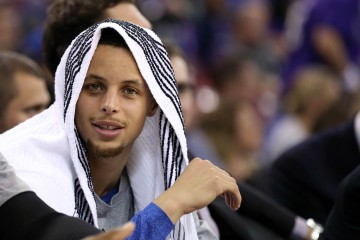 Feb 3, 2015; Sacramento, CA, USA; Golden State Warriors guard Stephen Curry (30) on the bench with a towel draped over his head during the fourth quarter against the Sacramento Kings at Sleep Train Arena. The Golden State Warriors defeated the Sacramento Kings 121-96. Mandatory Credit: Kelley L Cox-USA TODAY Sports