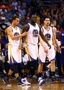 Mar 9, 2015; Phoenix, AZ, USA; Golden State Warriors guard Stephen Curry (30) with forward Draymond Green (23) and guard Klay Thompson (11) against the Phoenix Suns at US Airways Center. The Warriors defeated the Suns 98-80. Mandatory Credit: Mark J. Rebilas-USA TODAY Sports