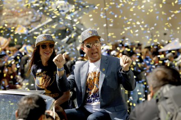 Jun 19, 2015; Oakland, CA, USA; Co-executive chairman and ceo Joe Lacob rides in a convertible during the Golden State Warriors 2015 championship celebration in downtown Oakland. Mandatory Credit: Cary Edmondson-USA TODAY Sports