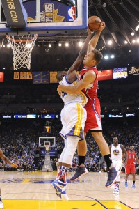 November 4, 2015; Oakland, CA, USA; Golden State Warriors center Festus Ezeli (31, left) blocks the shot of Los Angeles Clippers forward Blake Griffin (32, right) during the first quarter at Oracle Arena. The Warriors defeated the Clippers 112-108. Mandatory Credit: Kyle Terada-USA TODAY Sports