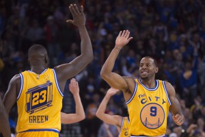 November 17, 2015; Oakland, CA, USA; Golden State Warriors guard Andre Iguodala (9) celebrates with forward Draymond Green (23) during the second quarter against the Toronto Raptors at Oracle Arena. Mandatory Credit: Kyle Terada-USA TODAY Sports