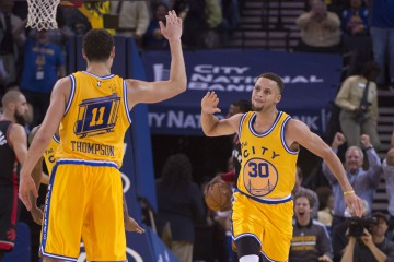 November 17, 2015; Oakland, CA, USA; Golden State Warriors guard Stephen Curry (30) celebrates with guard Klay Thompson (11) during the second quarter against the Toronto Raptors at Oracle Arena. Mandatory Credit: Kyle Terada-USA TODAY Sports