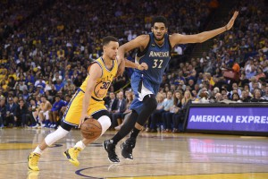 April 5, 2016; Oakland, CA, USA; Golden State Warriors guard Stephen Curry (30) dribbles the basketball against Minnesota Timberwolves center Karl-Anthony Towns (32) during the third quarter at Oracle Arena. The Timberwolves defeated the Warriors 124-117. Mandatory Credit: Kyle Terada-USA TODAY Sports