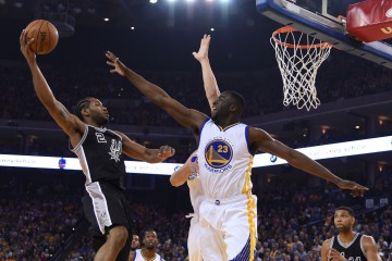 April 7, 2016; Oakland, CA, USA; San Antonio Spurs forward Kawhi Leonard (2) shoots the basketball against Golden State Warriors forward Draymond Green (23) during the first quarter at Oracle Arena. Mandatory Credit: Kyle Terada-USA TODAY Sports