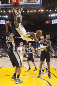 April 7, 2016; Oakland, CA, USA; Golden State Warriors forward Harrison Barnes (40) dunks the basketball against San Antonio Spurs forward LaMarcus Aldridge (12) and forward David West (30) during the third quarter at Oracle Arena. The Warriors defeated the Spurs 112-101. Mandatory Credit: Kyle Terada-USA TODAY Sports