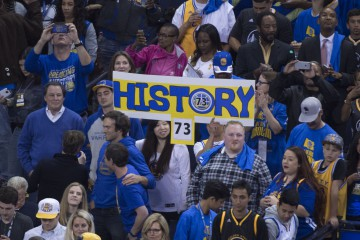 April 13, 2016; Oakland, CA, USA; Golden State Warriors fans hold a sign after the game against the Memphis Grizzlies at Oracle Arena. The Warriors defeated the Grizzlies 125-104. Mandatory Credit: Kyle Terada-USA TODAY Sports