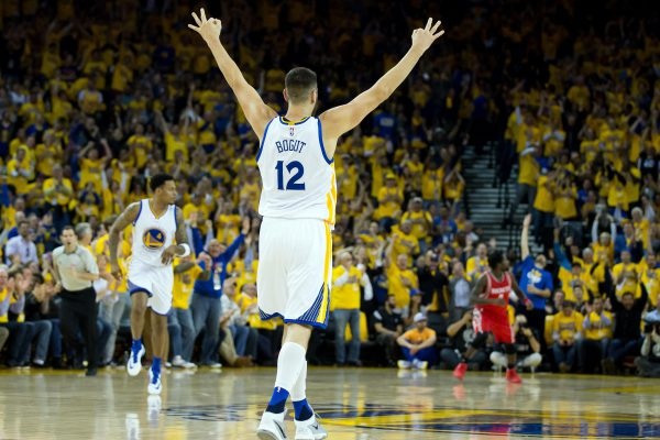 Apr 27, 2016; Oakland, CA, USA; Golden State Warriors center Andrew Bogut (12) celebrates after forward Brandon Rush (4) scores a three point basket against the Houston Rockets during the second quarter in game five of the first round of the NBA Playoffs at Oracle Arena. Mandatory Credit: Kelley L Cox-USA TODAY Sports
