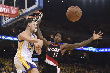 May 3, 2016; Oakland, CA, USA; Golden State Warriors guard Klay Thompson (11) passes the basketball against Portland Trail Blazers center Ed Davis (17) during the third quarter in game two of the second round of the NBA Playoffs at Oracle Arena. The Warriors defeated the Trail Blazers 110-99. Mandatory Credit: Kyle Terada-USA TODAY Sports