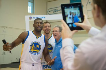 September 29, 2014; Oakland, CA, USA; Golden State Warriors center Festus Ezeli (31), forward David Lee (10), and broadcaster Jim Barnett (right) pose for an Instagram photo during media day at the Warriors Practice Facility. Mandatory Credit: Kyle Terada-USA TODAY Sports