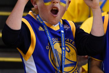 Jun 7, 2015; Oakland, CA, USA; Golden State Warriors fan Griffin Gustafson cheers before game two of the NBA Finals against the Cleveland Cavaliers at Oracle Arena. Mandatory Credit: Kyle Terada-USA TODAY Sports