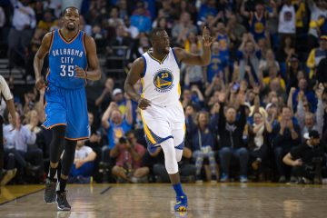 Mar 3, 2016; Oakland, CA, USA; Golden State Warriors forward Draymond Green (23) celebrates after a basket against Oklahoma City Thunder forward Kevin Durant (35) during the first quarter at Oracle Arena. Mandatory Credit: Kelley L Cox-USA TODAY Sports