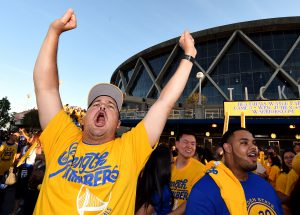 Jun 5, 2016; Oakland, CA, USA; Fans celebrate outside the arena after game two of the NBA Finals between the Golden State Warriors and the Cleveland Cavaliers at Oracle Arena. Mandatory Credit: Kyle Terada-USA TODAY Sports