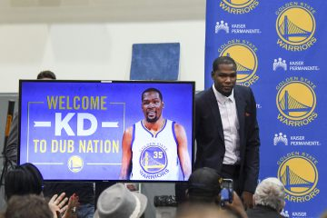 Jul 7, 2016; Oakland, CA, USA; Kevin Durant walks onto the stage during a press conference after signing with the Golden State Warriors at the Warriors Practice Facility. Mandatory Credit: Kyle Terada-USA TODAY Sports