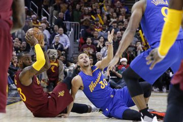 Dec 25, 2016; Cleveland, OH, USA; Cleveland Cavaliers forward LeBron James (32) comes up with a loose ball against Golden State Warriors guard Stephen Curry (30) at Quicken Loans Arena. Cleveland defeats Golden State 109-108. Mandatory Credit: Brian Spurlock-USA TODAY Sports