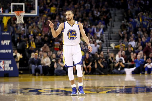 OAKLAND, CA - JANUARY 18:  Stephen Curry #30 of the Golden State Warriors reacts after the Warriors made a basket against the Oklahoma City Thunder at ORACLE Arena on January 18, 2017 in Oakland, California.  NOTE TO USER: User expressly acknowledges and agrees that, by downloading and or using this photograph, User is consenting to the terms and conditions of the Getty Images License Agreement.  (Photo by Ezra Shaw/Getty Images)
