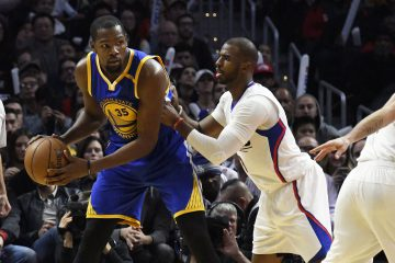 Dec 7, 2016; Los Angeles, CA, USA; Golden State Warriors forward Kevin Durant (35) controls the ball against LA Clippers guard Chris Paul (3) in the third quarter at Staples Center. Mandatory Credit: Richard Mackson-USA TODAY Sports