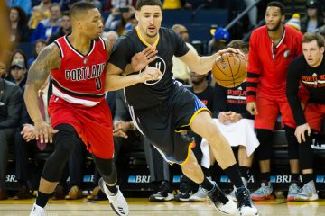 Dec 17, 2016; Oakland, CA, USA; Golden State Warriors guard Klay Thompson (11) drives in against Portland Trail Blazers guard Damian Lillard (0) during the third quarter at Oracle Arena. The Golden State Warriors defeated the Portland Trail Blazers 135-90. Mandatory Credit: Kelley L Cox-USA TODAY Sports