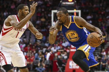 Jan 20, 2017; Houston, TX, USA; Golden State Warriors forward Kevin Durant (35) dribbles the ball as Houston Rockets forward Trevor Ariza (1) defends during the third quarter at Toyota Center. Mandatory Credit: Troy Taormina-USA TODAY Sports