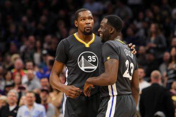Feb 4, 2017; Sacramento, CA, USA; Golden State Warriors forward Kevin Durant (35) talks with forward Draymond Green (23) during the third quarter against the Sacramento Kings at Golden 1 Center. The Kings defeated the Warriors 109-106 in OT. Mandatory Credit: Sergio Estrada-USA TODAY Sports