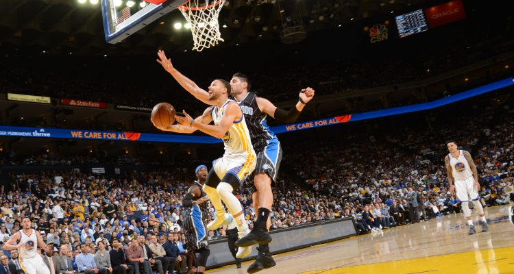 OAKLAND, CA - MARCH 16:  Stephen Curry #30 of the Golden State Warriors goes up for a shot during a game against the Orlando Magic on March 16, 2017 at ORACLE Arena in Oakland, California. NOTE TO USER: User expressly acknowledges and agrees that, by downloading and/or using this photograph, user is consenting to the terms and conditions of Getty Images License Agreement. Mandatory Copyright Notice: Copyright 2017 NBAE (Photo by Noah Graham/NBAE via Getty Images)
