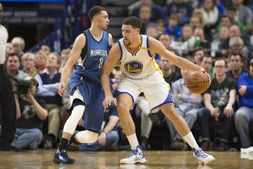 Dec 11, 2016; Minneapolis, MN, USA; Golden State Warriors guard Klay Thompson (11) dribbles the ball as Minnesota Timberwolves guard Zach LaVine (8) plays defense in the second half at Target Center. The Warriors won 116-108. Mandatory Credit: Jesse Johnson-USA TODAY Sports