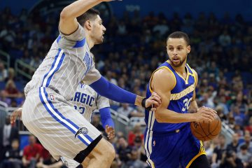 Jan 22, 2017; Orlando, FL, USA;  Golden State Warriors guard Stephen Curry (30) moves to the basket s Orlando Magic center Nikola Vucevic (9) defends during the first quarter at Amway Center. Mandatory Credit: Kim Klement-USA TODAY Sports