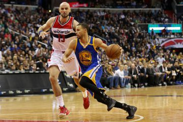 Feb 28, 2017; Washington, DC, USA; Golden State Warriors guard Stephen Curry (30) dribbles the ball a Washington Wizards center Marcin Gortat (13) defends in the fourth quarter at Verizon Center. The Wizards won 112-108. Mandatory Credit: Geoff Burke-USA TODAY Sports