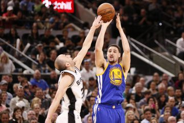 Mar 29, 2017; San Antonio, TX, USA; Golden State Warriors shooting guard Klay Thompson (11) shoots the ball over San Antonio Spurs shooting guard Manu Ginobili (20) during the second half at AT&T Center. Mandatory Credit: Soobum Im-USA TODAY Sports
