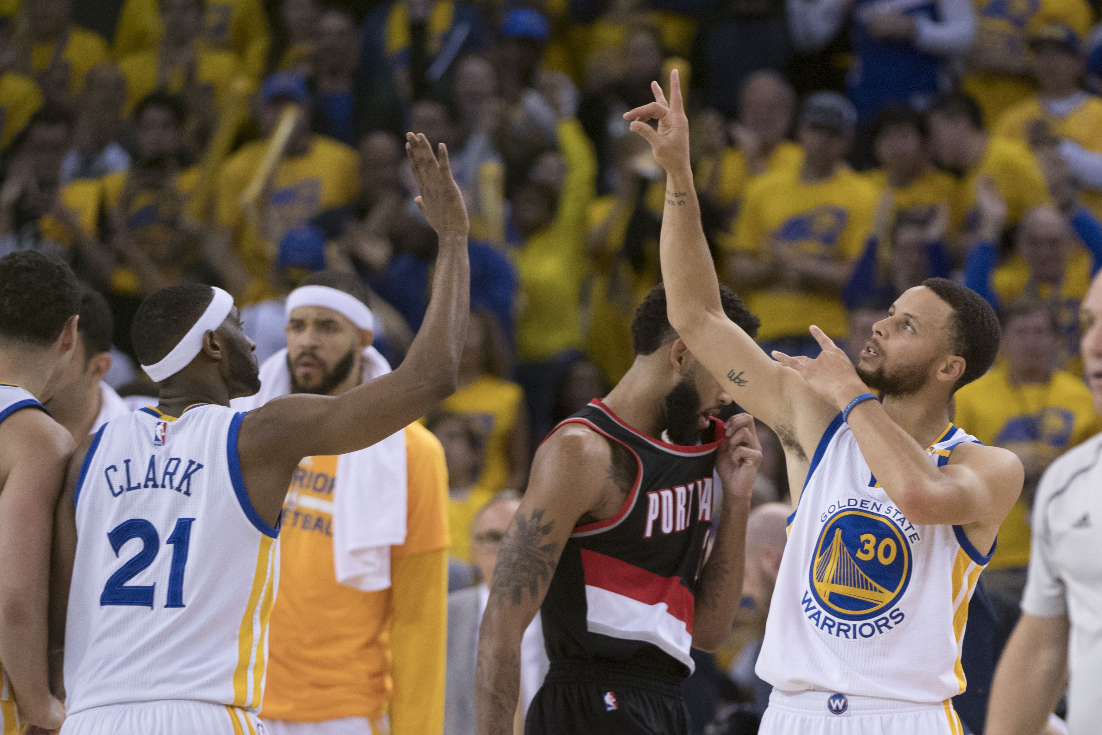 April 16, 2017; Oakland, CA, USA; Golden State Warriors guard Stephen Curry (30) celebrates with guard Ian Clark (21) against the Portland Trail Blazers during the fourth quarter in game one of the first round of the 2017 NBA Playoffs at Oracle Arena. The Warriors defeated the Trail Blazers 121-109. Mandatory Credit: Kyle Terada-USA TODAY Sports